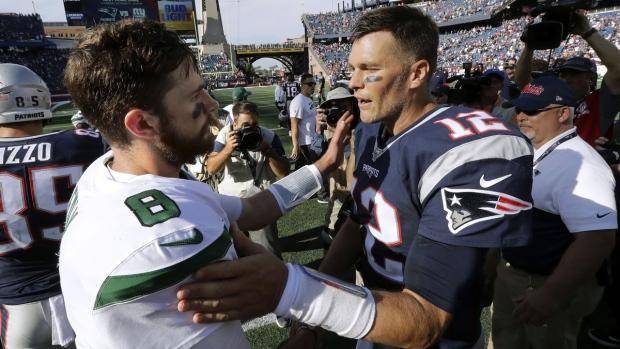 New York Jets quarterback Luke Falk, left, and New England Patriots quarterback Tom Brady speak in Foxborough, Mass., on Sept. 22, 2019. (Steven Senne / AP)