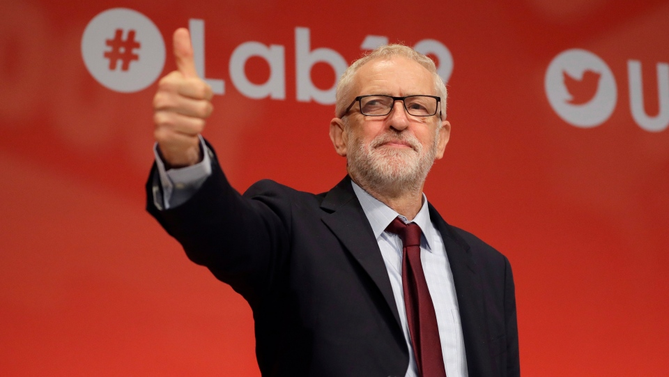 Jeremy Corbyn, leader of Britain's opposition Labour Party gives a thumbs up as reaction to the news from Britain's Supreme Court, on stage during the Labour Party Conference at the Brighton Centre in Brighton, England, Tuesday, Sept. 24, 2019. (AP Photo/Kirsty Wigglesworth)