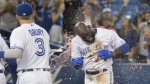 Toronto Blue Jays' Anthony Alford gets a sports drink shower as he arrives at home plate after a walk-off home run to end the 15th inning of American League MLB baseball action against the Baltimore Orioles, in Toronto, Tuesday, Sept. 24, 2019. THE CANADIAN PRESS/Fred Thornhill