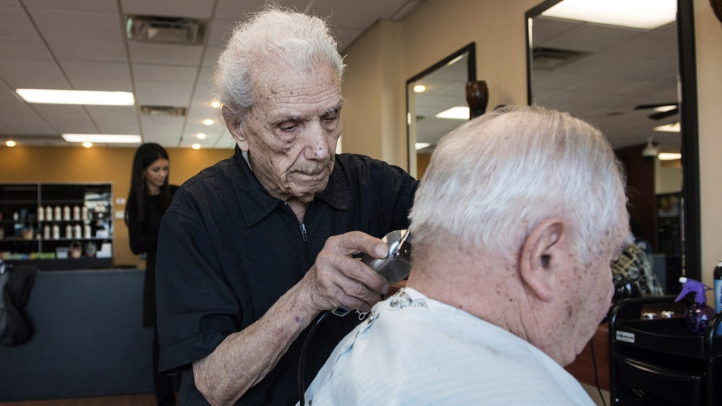 Anthony Mancinelli giving his son a haircut