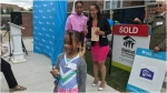 Coriah Feliz holds the key to her family's new home alongside her sister and mother. (CTV News Toronto/Nick Dixon)