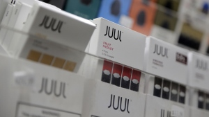 Juul products are displayed at a smoke shop in New York, on Dec. 20, 2018. (Seth Wenig / AP)