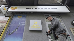 A man passes by a still opened bureau of Neckermann Polska that said it was entering bankruptcy proceedings while some 3,600 Polish tourists were still abroad, after its British parent company Thomas Cook entered liquidation. (Czarek Sokolowski / AP)