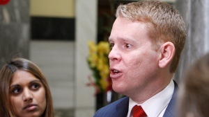 Education Minister Chris Hipkins speaks to reporters on Wednesday, Sept. 25, 2019, in Wellington, New Zealand. Hipkins called for an investigation after reports that a student's body lay undiscovered in a university dorm room for nearly eight weeks.(AP Photo/Nick Perry)