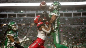 Saskatchewan Roughriders defensive back Ed Gainey (11) wrestles for the ball with Calgary Stampeders wide receiver Markeith Ambles (17) during first half CFL action in Regina on Saturday, July 6, 2019. After a disappointing 37-10 loss to Calgary Stampeders on July 6, the Saskatchewan Roughriders are hoping a bye week, followed by a good week of practice, will enable them to get back on the right track Saturday against the B.C. Lions on Saturday. THE CANADIAN PRESS/Matt Smith