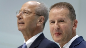 Volkswagen CEO Herbert Diess, right, and Hans Dieter Poetsch, left, chairman of the board of directors of Volkswagen in Wolfsburg, Germany, on April 13, 2018. (Michael Sohn / AP)