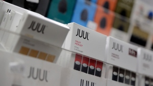 FILE - In this Dec. 20, 2018, file photo Juul products are displayed at a smoke shop in New York. A commitment by San Francisco-based Juul Labs to no longer promote its e-cigarettes in print, digital and TV advertisements applies only in the United States, not in Canada, a spokesman says. THE CANADIAN PRESS/AP-Seth Wenig