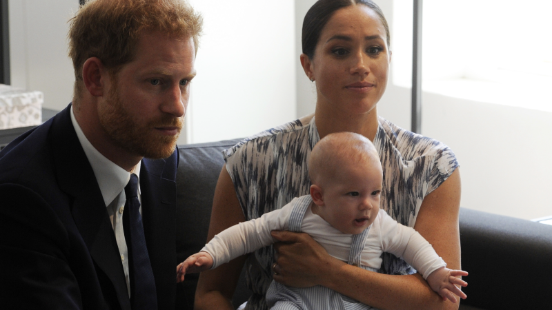 Prince Harry and Meghan, Duchess of Sussex, holding their son Archie, meet with Anglican Archbishop Emeritus, Desmond Tutu in Cape Town, South Africa, on Sept. 25, 2019. (Henk Kruger / African News Agency via AP, Pool)
