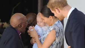FILE - Prince Harry and Meghan, Duchess of Sussex, holding their son Archie, meet with Anglican Archbishop Emeritus, Desmond Tutu, in Cape Town, South Africa, Wednesday, Sept. 25, 2019. (Henk Kruger/African News Agency via AP, Pool)