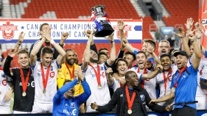 Montreal Impact midfielder Ignacio Piatti (10) raises the Voyageurs Cup alongside his team after defeating Toronto FC in the second leg of Canadian Champion soccer action in Toronto, Wednesday, Sept. 25, 2019. THE CANADIAN PRESS/Cole Burston