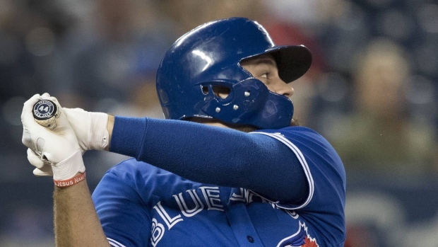 Toronto Blue Jays' Rowdy Tellez hits a home run against the Baltimore Orioles in the sixth inning of their American League MLB baseball game in Toronto on Wednesday, September 25, 2019. THE CANADIAN PRESS/Fred Thornhill