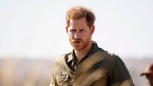 Prince Harry attends a tree planting event with local children, at the Chobe National Park, Botswana, Thursday, Sept. 26, 2019 on day four of the royal tour of Africa. (Dominik Lipinski/Pool via AP)