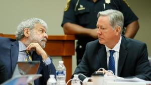 "Robert ""Chip"" Olsen, right, confers with attorney Don Samuel as they prepare to strike a jury in Olsen's murder trial, Thursday, Sept. 26, 2019, in Decatur, Ga. The former DeKalb County police officer faces charges including felony murder in the March 9, 2015, death of Anthony Hill. (Bob Andres/Atlanta Journal-Constitution via AP)"