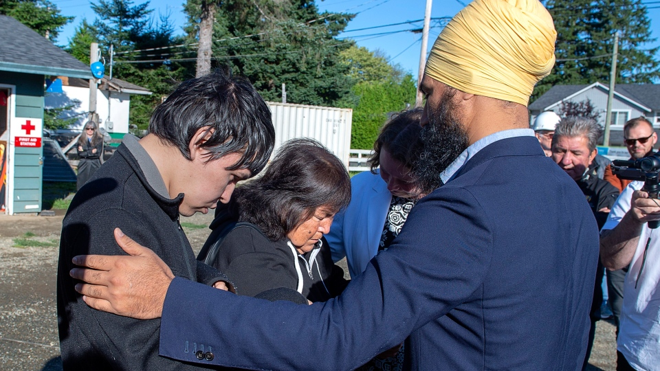 NDP Leader Jagmeet Singh talks with Betty Nicolaye and one of her three children as he makes a campaign stop with Rachel Blaney, NDP Candidate for North Island-Powell River, at a Habitat for Humanity project in Campbell River, B.C. on Thursday, Sept. 26, 2019. The family is homeless and living in their van. (THE CANADIAN PRESS/Andrew Vaughan)
