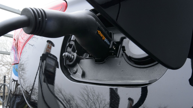 A car is charged at a charge station for electric vehicles on Parliament Hill in Ottawa on Wednesday, May 1, 2019. THE CANADIAN PRESS/Sean Kilpatrick