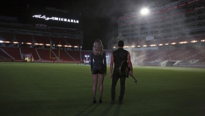Shannon Haley and Ryan Michaels during the shooting of a music video at Levi's Stadium in Santa Clara, Calif.  (Jon-Paul Bruno via AP)