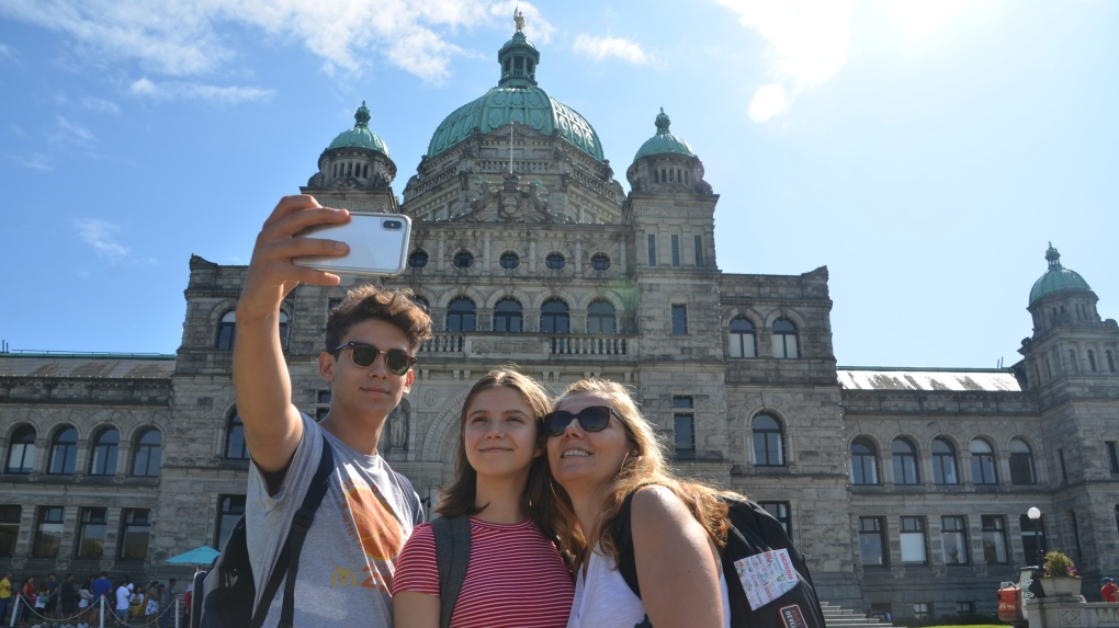 Family visiting from Vancouver poses for a selfie
