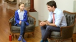 Liberal Leader Justin Trudeau speaks to Swedish environmental activist Greta Thunberg in Montreal on Friday, September 27, 2019. THE CANADIAN PRESS/Ryan Remiorz