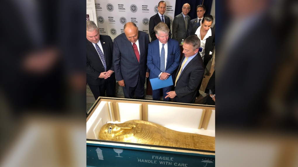 Officials says ancient gilded coffin arrived in Egypt