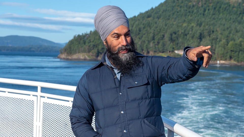 NDP Leader Jagmeet Singh takes in the sights after a media availability as he takes a ferry from Victoria to a campaign event in Vancouver on Saturday, Sept. 28, 2019. THE CANADIAN PRESS/Andrew Vaughan