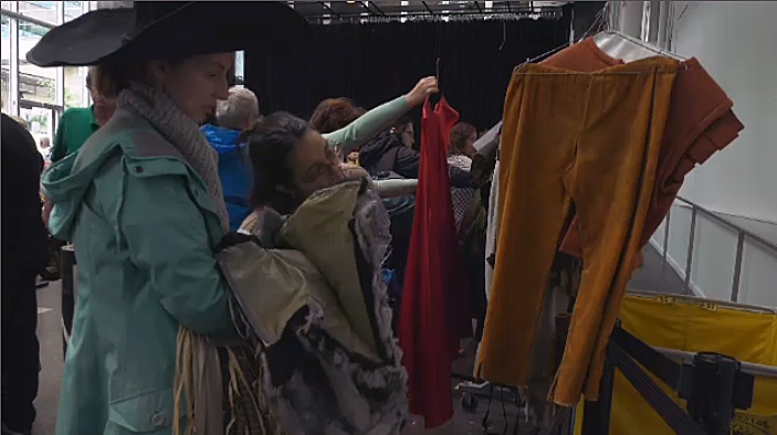Opera and costume fans line up in the rain for costume auction