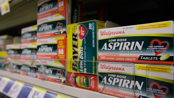 Packages of aspirin fill the shelves of a drugstore in Chicago, on Tuesday, Aug. 11, 2009. (AP / M. Spencer Green)