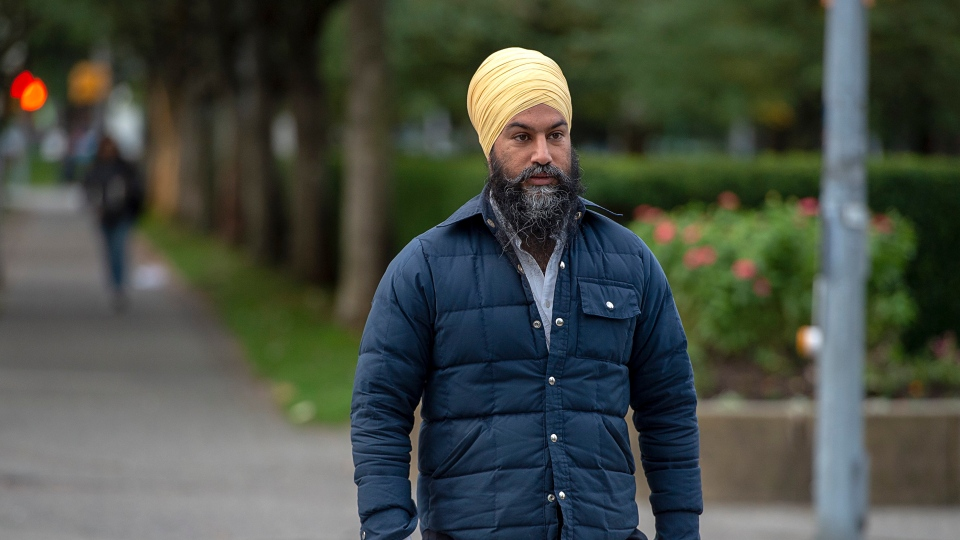 NDP Leader Jagmeet Singh heads to the bus on the way to a campaign event in Burnaby, B.C. on Sunday, Sept. 29, 2019. THE CANADIAN PRESS/Andrew Vaughan