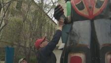 Stolen totem pole hand returned