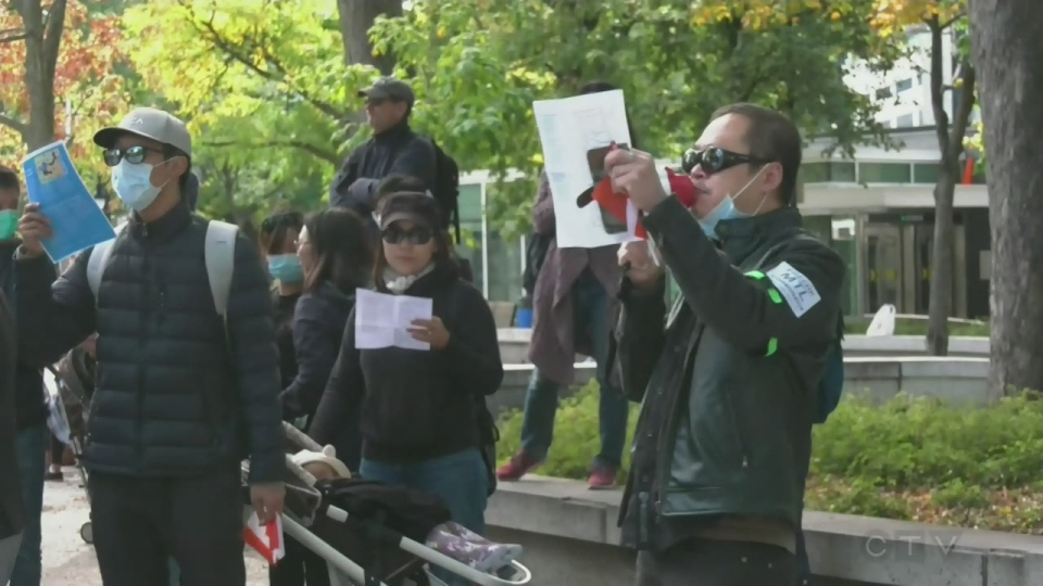 Protesters denouncing 70 years of the Communist Party's rule of China faced government supporters on Sunday, Sept. 29, 2019 in Montreal.