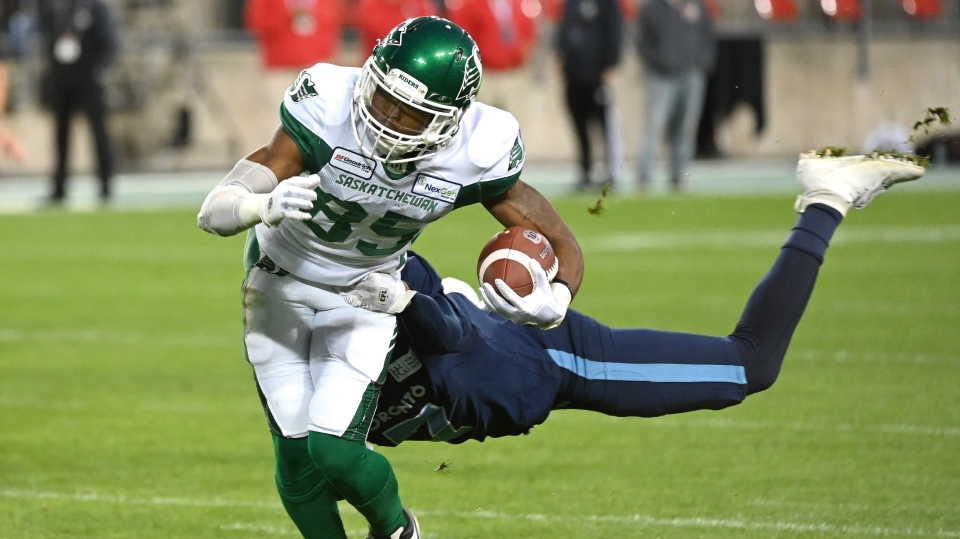 Saskatchewan Roughriders wide receiver Kyran Moore, left, is tackled by Toronto Argonauts defensive back Rob Woodson during first half CFL football game action in Toronto on Saturday, September 28, 2019. THE CANADIAN PRESS/Jon Blacker