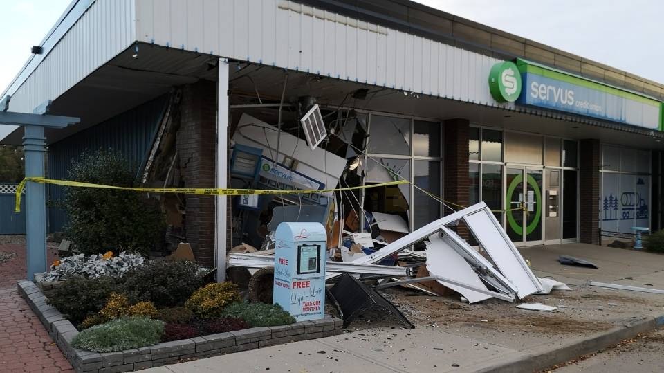 Pictures show a destroyed corner of Servus Credit Union in Legal, Alta. following a reported theft, Sept. 30, 2019. (Ilse Buma/Facebook)