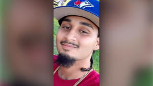Toronto police say Amir Naraine, 21, was found dead with a gunshot wound inside a car parked at an Etobicoke plaza on Sunday.