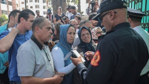 Observers and relatives prepare to enter a court where journalist Hajar Rissouni is being tried on accusations of undergoing an illegal abortion, in Rabat, Morocco, Monday, Sept. 30, 2019. (AP Photo/Mosa'ab Elshamy)