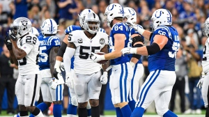 Oakland Raiders outside linebacker Vontaze Burfict (55) speaks with Indianapolis Colts tight end Jack Doyle (84) after his helmet-to-helmet hit on Doyle during the first half of an NFL football game in Indianapolis, Sunday, Sept. 29, 2019. (AP Photo/Doug McSchooler)