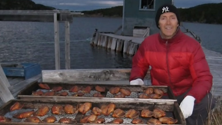 Michael Parsons shows off smoked fish at their Little Bay Islands home. (Parsons)