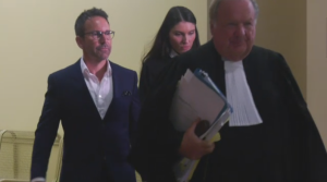 Eric Salvail walks through the Montreal courthouse on Sept. 30, 2019