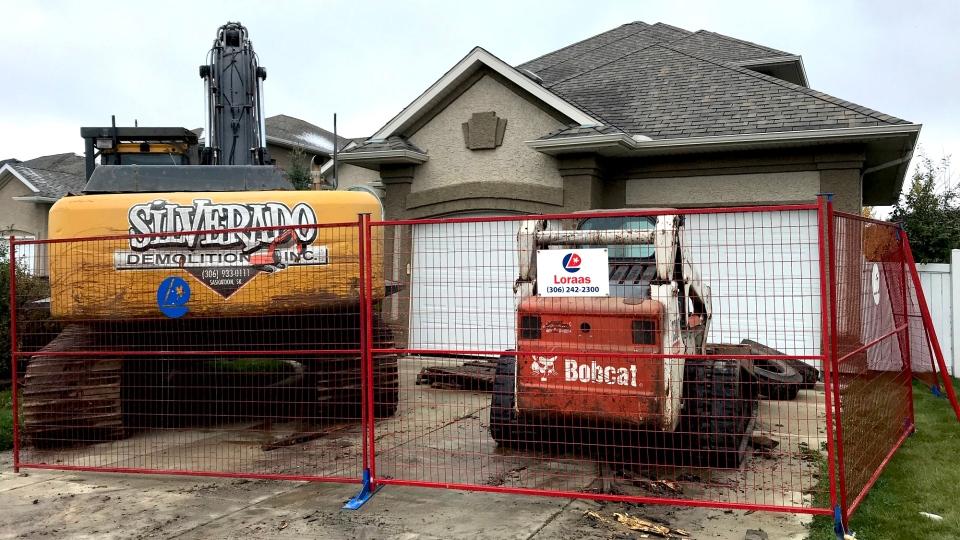 Heavy machinery poised to demolish a home located in an upscale Saskatoon neighborhood. (Dale Cooper/CTV Saskatoon)