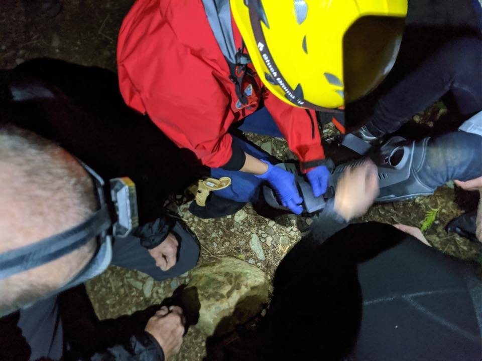 Search and rescue crews help a woman who hurt her ankle while hiking. Photo: North Shore Rescue