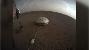 This April 25, 2019 photo made available by NASA shows the InSight lander's dome-covered seismometer, known as SEIS, on Mars. On Tuesday, Oct. 1, 2019, scientists released an audio sampling of marsquakes and other sounds recorded by the probe. (NASA/JPL-Caltech via AP)