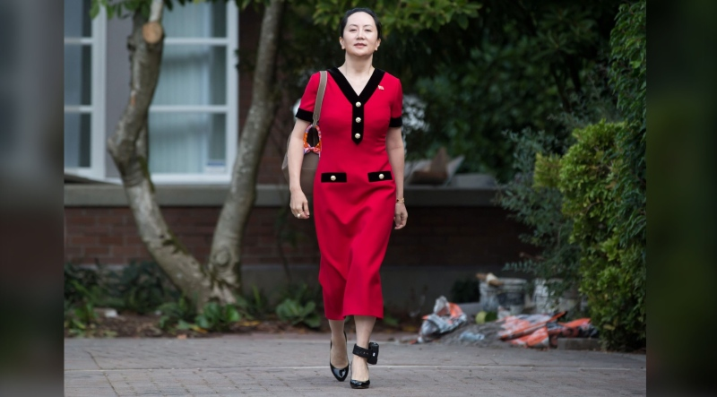 Huawei chief financial officer Meng Wanzhou, who is out on bail and remains under partial house arrest after she was detained last year at the behest of American authorities, wears a Chinese flag pin on her dress as she leaves her home to attend a court hearing, in Vancouver, on Tuesday Oct. 1, 2019. THE CANADIAN PRESS/Darryl Dyck