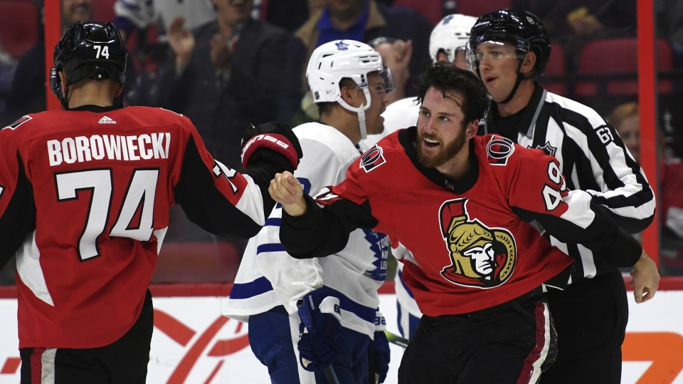 Ottawa Senators right wing Scott Sabourin (49) high fives teammate Mark Borowiecki (74) after fighting with Toronto Maple Leafs defenceman Ben Harpur (22), not shown, during first period of preseason NHL hockey action in Ottawa, Wednesday September 18, 2019. THE CANADIAN PRESS/Justin Tang