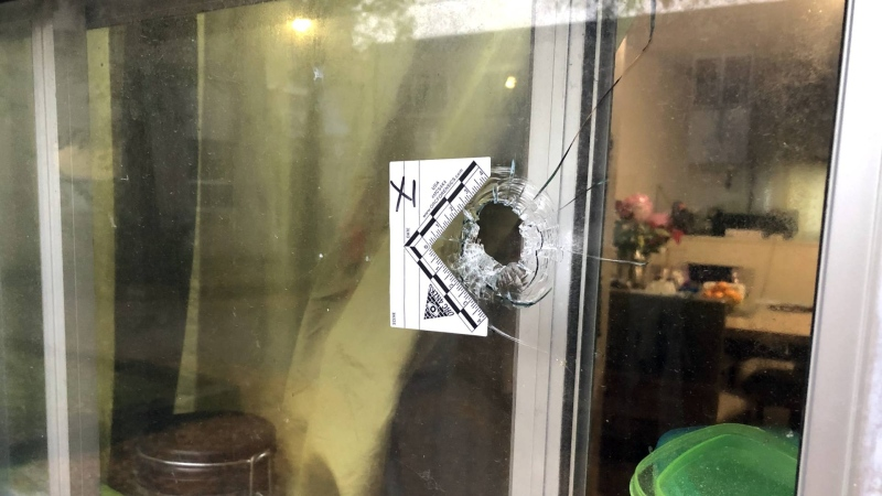 A bullet hole is seen at the scene of a double homicide in North York. (CTV News Toronto / Carol Charles)