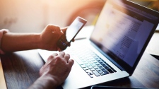 People are getting faster at typing on mobile devices and slower on physical keyboards. (Shutterstock / CNN)