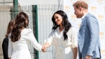 Prince Harry and Meghan, Duchess of Sussex visit a Youth Employment Services Hub in Makhulong, Tembisa, a township near Johannesburg, South Africa, Wednesday Oct. 2, 2019. (AP Photo/Christiaan Kotze)