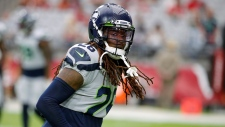 In this Sept. 29, 2019, file photo, Seattle Seahawks cornerback Shaquill Griffin (26) is shown during an NFL football game against the Arizona Cardinals, in Glendale, Ariz. Griffin was so disappointed by his second NFL season he changed his entire offseason routine. Slimmer and faster, the Seahawks cornerback has been excellent through four games and will get another major test on Thursday against the Rams. (AP Photo/Rick Scuteri, File)