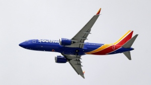 In this Wednesday, March 13, 2019, file photo, a Southwest Airlines Boeing 737 Max 8 jet flies over Mesa, Ariz., en route to Phoenix's Sky Harbor International Airport. (AP Photo/Elaine Thompson, File)