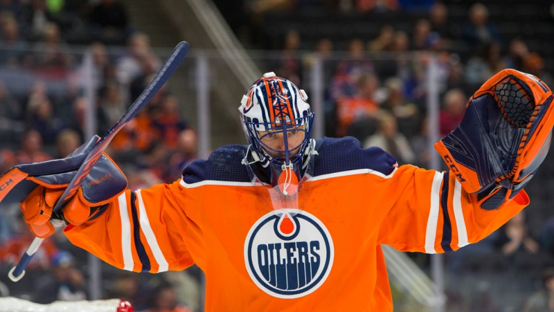 Edmonton Oilers goalie Mike Smith (41) stretches during first period NHL hockey pre-season action against the Arizona Coyotes in Edmonton, Alta., on Tuesday September 24, 2019. THE CANADIAN PRESS/Amber Bracken