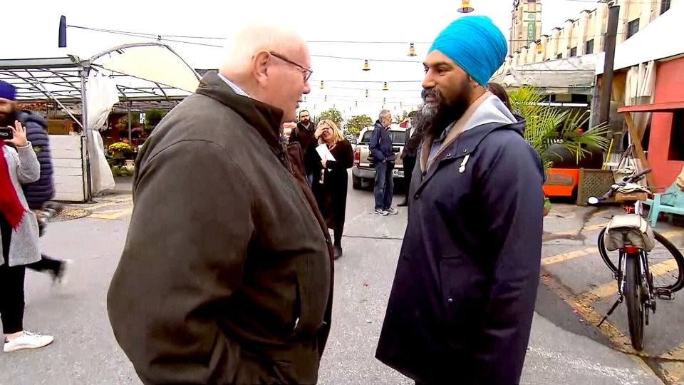 NDP Leader Jagmeet Singh was confronted about his turban during a visit to Montreal's Atwater Market on Oct. 2, 2019.