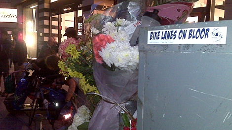 Flowers accumulate on Tuesday, Sept. 1, 2009 at the location on Bloor Street where Darcy Allan Sheppard suffered mortal injuries the previous evening.