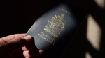 A Canadian passport is displayed in Ottawa on Thursday, July 23, 2015. THE CANADIAN PRESS/Sean Kilpatrick